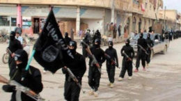 """FILE - This undated file image posted on a militant website on Tuesday, Jan. 14, 2014 shows fighters from the al-Qaida linked Islamic State of Iraq and the Levant (ISIL) marching in Raqqa, Syria. The  ISIL led by Abu Bakr al-Baghdadi, who is believed to have been operating from inside Syria in recent months, is the main driver of destabilizing violence in Iraq and until recently was the main al-Qaida affiliate there. Al-Qaida's general command formally disavowed the group this week, saying it """"is not responsible for its actions."""" (AP Photo/militant website, File)"""